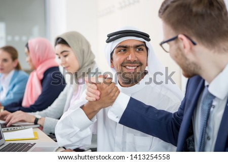 Multiethnic group of business people consulting a project #1413254558