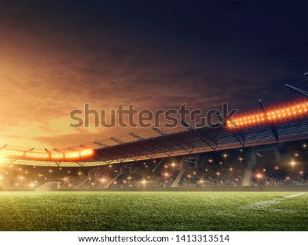 Night soccer stadium with green grass and dramatic sky Royalty-Free Stock Photo #1413313514