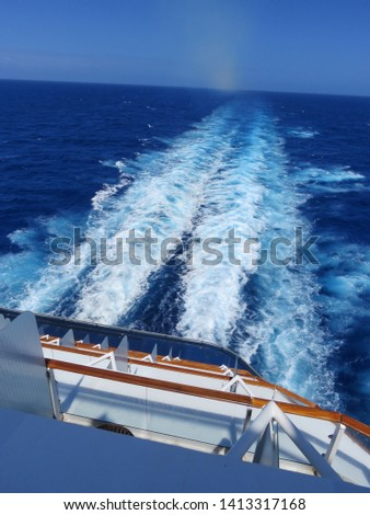Turbulent but beautiful, white and blue wake from the stern of a huge cruise ship, in the deep blue waters of the Caribbean  #1413317168