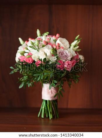 beautiful wedding bouquet on a dark background #1413340034