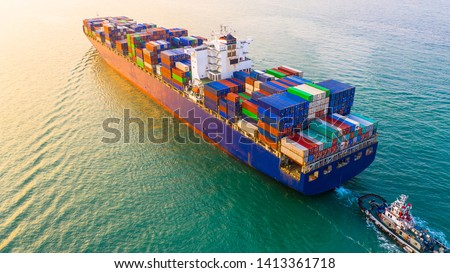 Container ship sailing through the ocean, Business logistics and transportation of International container ship in the ocean freight transportation, Aerial view Container loading cargo freight ship. #1413361718