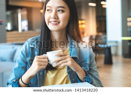Asian woman in a cafe drinking coffee .Portrait of Asian woman smiling in coffee shop cafe vintage color tone. #1413418220