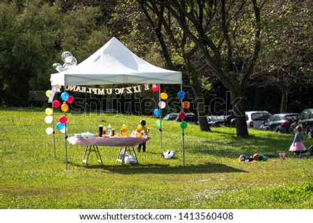 happy birthday tent in the yard or celebration tent or celebration day or happy birthday tent full of balloons , drinks and snacks or  celebration or happy birthday canopy tent #1413560408
