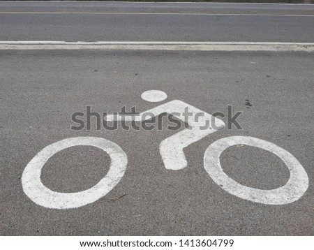bicycle signs on asphalt road  #1413604799