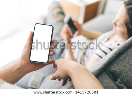 Mockup image screen cell phone.men hand holding texting using mobile with copy space,white blank screen for text.concept for contact business,people communication,technology electronic device #1413720581