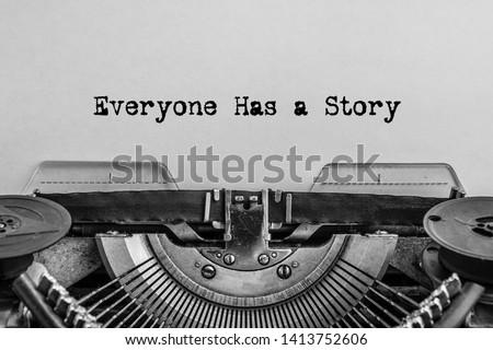 Everyone has a story printed on a vintage typewriter. #1413752606