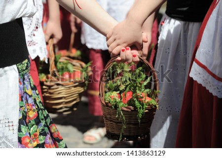 Nemi, Italy - june 2nd, 2019: children in typical dresses attending the annual strawberry festival takes place in the town of Nemi in the Castelli Romani, just south of Rome #1413863129