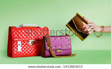 Group of beautiful purses bags.  Shopping image. #1413863615