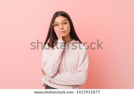 Young pretty arab woman wearing a casual sport look who is bored, fatigued and need a relax day.
