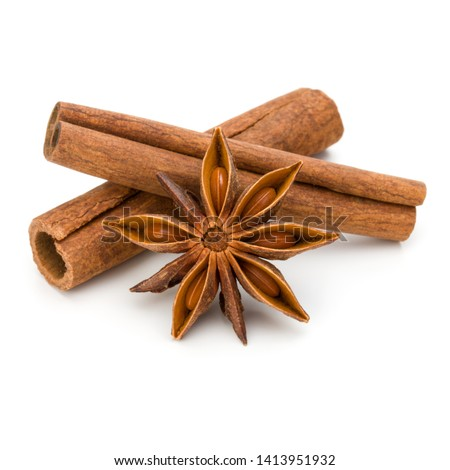 Cinnamon sticks and anise star isolated on white background close up #1413951932