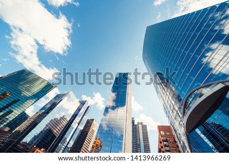 Modern tower buildings or skyscrapers in financial district with cloud on sunny day in Chicago, USA. Construction industry, business enterprise organization, or communication technology concept #1413966269
