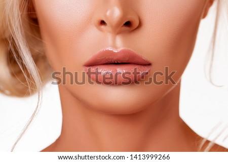 Sexy plump Lips Close-up.  Lip Gloss. Beautiful  Perfect Makeup. Beautiful lips. Beauty. Cosmetic lips. Cosmetic beauty procedures. - image                                #1413999266