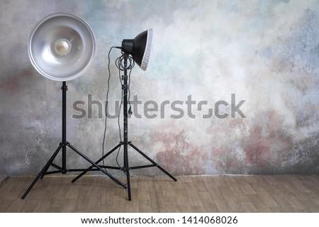 Professional lighting equipment in the photo studio on the original gray background, minimalist interior and lighting equipment #1414068026