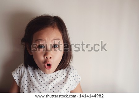 Portrait of surprising and shocking mixed race child, Asian young little girl, Opening holidays Christmas present box, unexpected surprise birthday gift concept #1414144982
