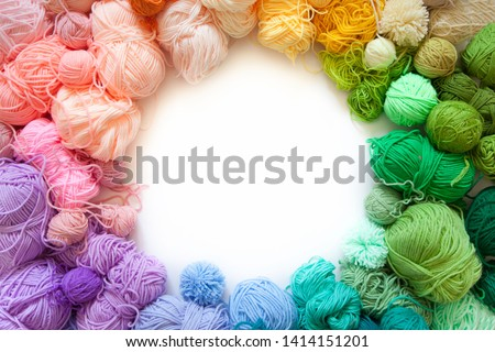 Colored balls of yarn. View from above. Rainbow colors. All colors. Yarn for knitting. Skeins of yarn. #1414151201
