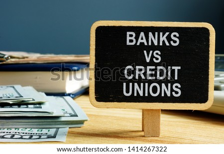 Banks vs Credit Unions concept. Money and ledger. Royalty-Free Stock Photo #1414267322