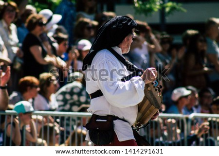 Reims France June 2, 2019 View of people disguised as medieval character unfolding in the streets during the Johanniques feast, annual French celebration in Reims #1414291631