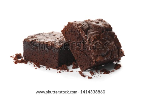 Pieces of fresh brownie on white background. Delicious chocolate pie #1414338860