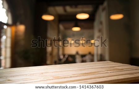 blurred background of bar and dark brown desk space of retro wood #1414367603