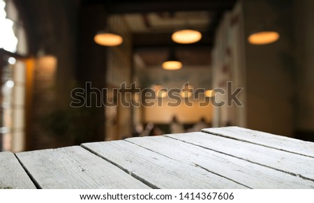 blurred background of bar and dark brown desk space of retro wood #1414367606
