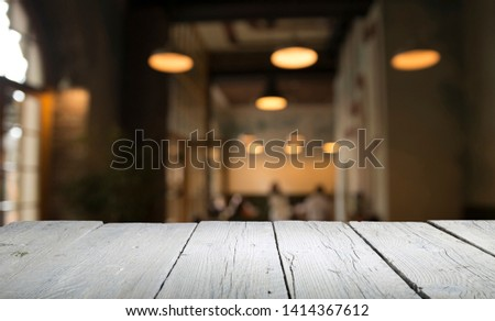 blurred background of bar and dark brown desk space of retro wood #1414367612
