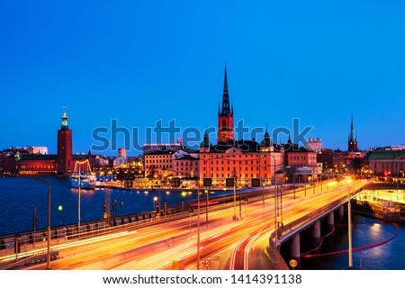 Stockholm, Sweden. View of Gamla Stan in Stockholm, Sweden with landmarks like Riddarholm Church during the night. View of old buildings and car traffic at the bridge #1414391138