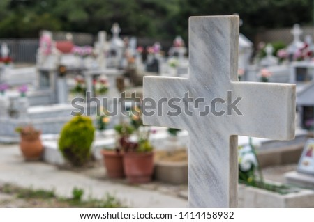 Marble cross in cemetery. Tomb decoration. Memorizing loved ones. Royalty-Free Stock Photo #1414458932