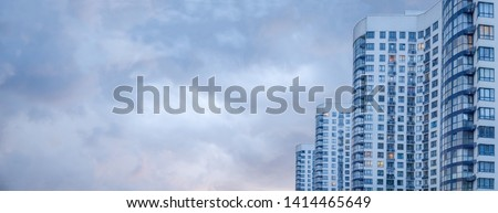 Banner of Modern and luxury building. copy space Modern european complex of apartment buildings. And outdoor facilities. Apartment building. Side view of big building with appartements at dusk #1414465649