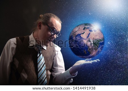 Funny scientist looking to universe and planet earth #1414491938