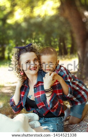 Mother with son pin up style cloth together portrait  #1414521338