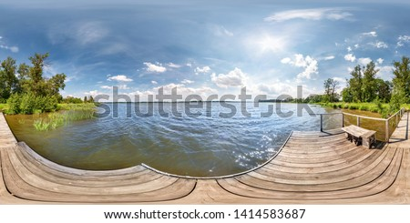 full seamless spherical hdri panorama 360 degrees  angle view on wooden pier of huge lake or river in sunny summer day and windy weather with beautiful clouds in equirectangular projection, VR content #1414583687