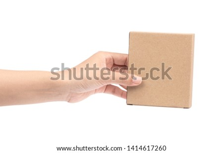 hand holding brown paper box package isolated on white background #1414617260