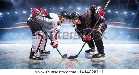 Hockey players starts game. around Ice rink arena  #1414628111