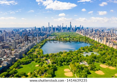 Aerial view of the Central park in New York with golf fields and tall skyscrapers surrounding the park. #1414639235