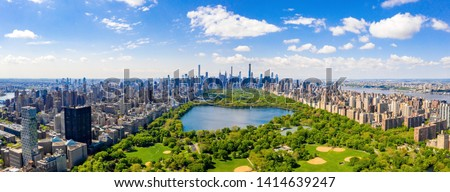 Aerial view of the Central park in New York with golf fields and tall skyscrapers surrounding the park. #1414639247