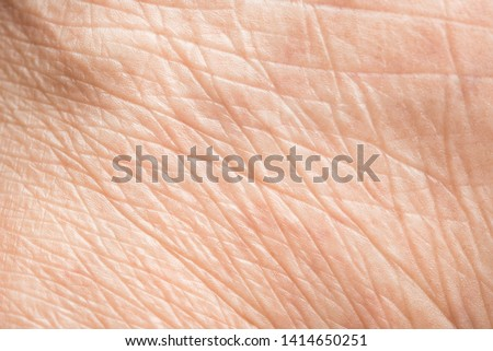 Close up old skin texture with wrinkles on body human Royalty-Free Stock Photo #1414650251