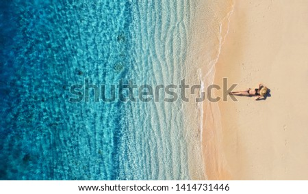 Aerial view of a girl on the beach. Vacation and adventure. Beach and turquoise water. Top view from drone at beach, azure sea and relax girl. Travel and relax - image #1414731446