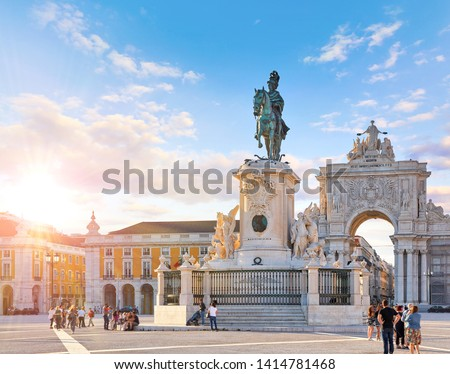 Lisbon, Portugal. King Jose I Statue at Praca do Comercio in front of Triumphal Arch near waterfront. Old town of Lisboa in historic midtown Alfama district. Evening sunset and blue sky with clouds. #1414781468