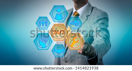 Unrecognizable male business manager is activating 24/7 service buttons on a virtual touch screen. Information technology and business concept for managed services, help desk, remote assistance. #1414821938