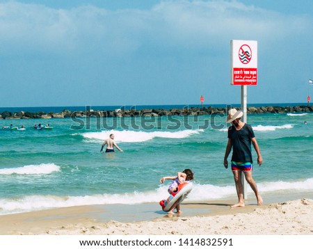 Tel Aviv Israel June 2, 2019 View of unknown Israeli children and parent having fun on the beach of Tel Aviv in the afternoon #1414832591