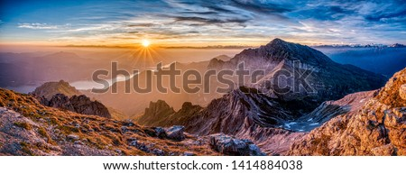 Sunset view on the top of Grigna Meridionale - aka Grignetta - in the Lake of Como district near Lecco. Red sky and a nice view. Mountain landscape, Italy #1414884038