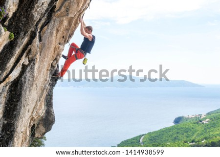 Man Climbing in Medveja, Croatia  #1414938599