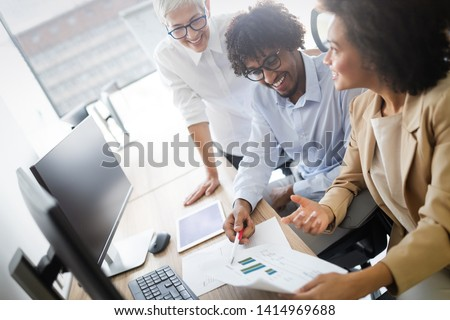 Successful group of business people at work in office #1414969688