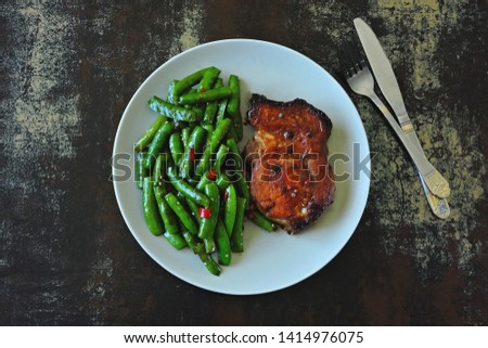 Pork steak and string beans. Keto diet. Paleo diet. Pegan Diet. #1414976075