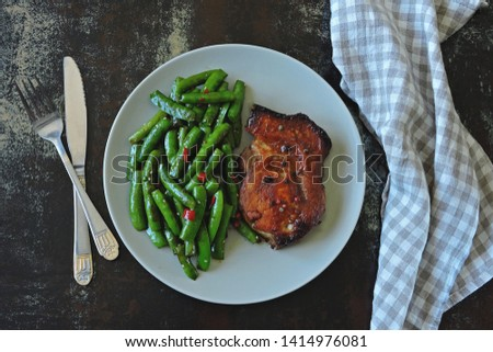 Pork steak and string beans. Keto diet. Paleo diet. Pegan Diet. #1414976081