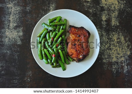 Pork steak and string beans. Keto diet. Paleo diet. Pegan Diet. #1414992407