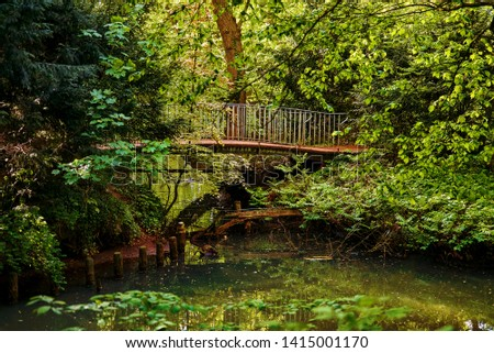 Pedestrian bridge over the small river Delme in Delmenhorst   Royalty-Free Stock Photo #1415001170