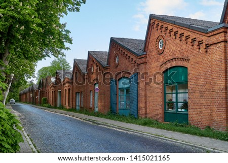 old traditional factory building of the former spinning mill in Delmenhorst (Germany) now used as apartment house Royalty-Free Stock Photo #1415021165