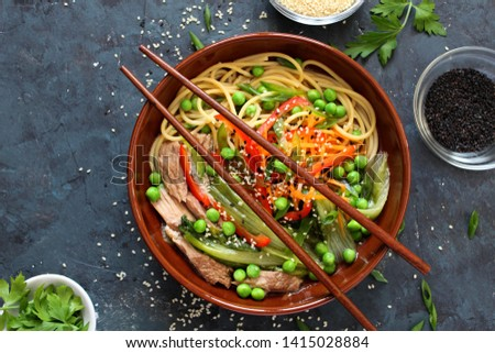 Noodles with beef and vegetables. Asian food. Top view with copy space. #1415028884