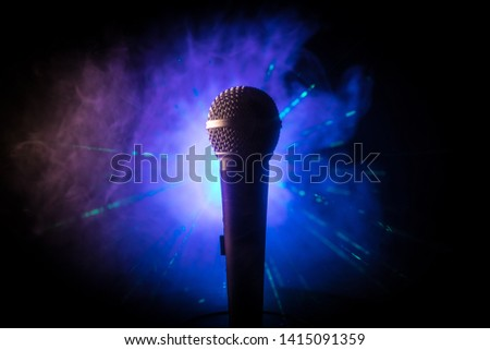 Microphone for sound, music, karaoke in audio studio or stage. Mic technology. Voice, concert entertainment background. Speech broadcast equipment. Live pop, rock musical performance #1415091359